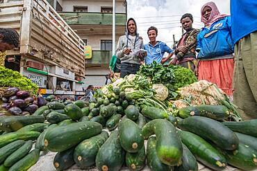 Addis Ababa, Ethiopia- Locals buying and selling vegetables at Addis Mercato, the largest open air market in Africa.