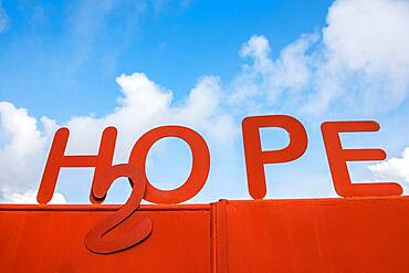 """Bright red rusted sign reads """"hope"""". Ganta Liberia"""