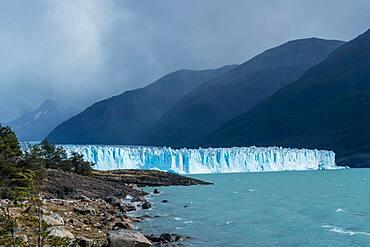 Perito Moreno Glacier and Lago Argentino in Los Glaciares National Park near El Calafate, Argentina.  A UNESCO World Heritage Site in the Patagonia region of South America.  At right is Cordon Reichert