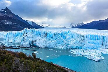 Perito Moreno Glacier and Lago Argentino in Los Glaciares National Park near El Calafate, Argentina.  A UNESCO World Heritage Site in the Patagonia region of South America.  At right is Cordon Reichert with the peak of Cerro Moreno at left.