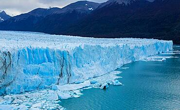 Perito Moreno Glacier and Lago Argentino in Los Glaciares National Park near El Calafate, Argentina.  A UNESCO World Heritage Site in the Patagonia region of South America.  At right is Cordon Reichert.