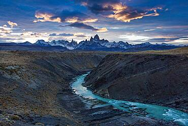 The Fitz Roy Massif at sunset, viewed over the canyon of the Rio de las Vueltas in Los Glaciares National Park near El Chalten, Argentina.  A UNESCO World Heritage Site in the Patagonia region of South America.