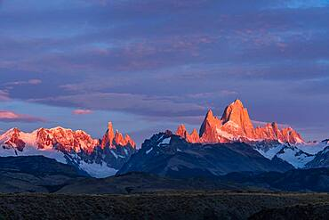 First light on Mount Fitz Roy and Cerro Torre in Los Glaciares National Park near El Chalten, Argentina.  A UNESCO World Heritage Site in the Patagonia region of South America.
