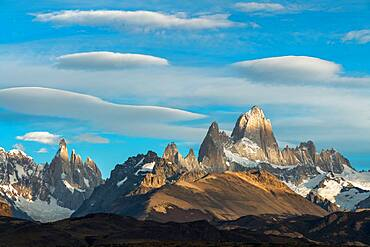 Mottled light and shadow on Mount Fitz Roy and Cerro Torre in Los Glaciares National Park near El Chalten, Argentina.  A UNESCO World Heritage Site in the Patagonia region of South America.