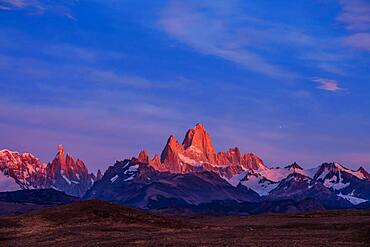 The Fitz Roy Massif in pastel pre-dawn morning twilight.   Los Glaciares National Park near El Chalten, Argentina.  A UNESCO World Heritage Site in the Patagonia region of South America.