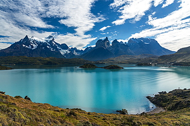 A morning view of the Paine Massif across Lago Pehoe in Torres del Paine National Park, a UNESCO World Biosphere Reserve in Chile in the Patagonia region of South America.