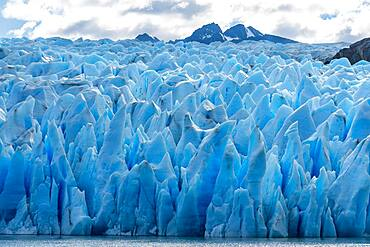 The jaggedly sculpted face of the Grey Glacier on Lago Grey in Torres del Paine National Park, a UNESCO World Biosphere Reserve in Chile in the Patagonia region of South America.