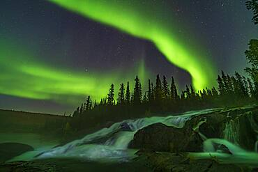 Curtains of aurora over the Ramparts falls on the Cameron River near Yellowknife, NWT, on Sept 8, 2019.