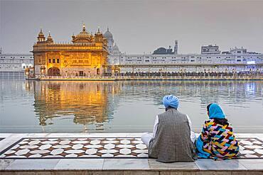 pilgrims and sacred pool Amrit Sarovar, Golden temple, Amritsar, Punjab, India