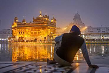pilgrim and sacred pool Amrit Sarovar, Golden temple, Amritsar, Punjab, India