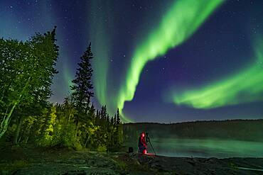 Photographer Stephen Bedingfield is shooting the Northern Lights at the Ramparts waterfalls on the Cameron River, September 8, 2019. The Big Dipper is at centre. The aspen trees are nicely turning colour.