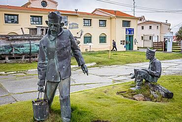 Prisoners sculptures and facade of El Presidio, the former prison, now the Maritime museum and Presidio museum. Ushuaia, Tierra del Fuego, Patagonia, Argentina