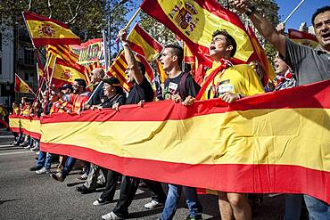 Anti-independence Catalan protestors carry Spanish flags and catalan flags during a demonstration for the unity of Spain on the occasion of the Spanish National Day at Passeig de Gracia, Barcelona on October 12, 2014, Spain
