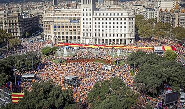 Anti-independence Catalan protestors during a demonstration for the unity of Spain on the occasion of the Spanish National Day at Catalunya square in Barcelona on October 12, 2014