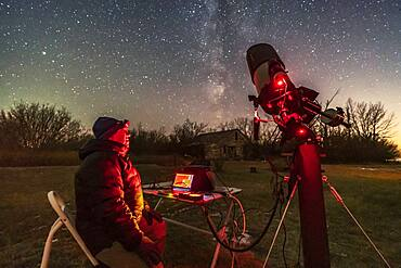 A session shooting deep-sky objects in the rural backyard in Alberta, on a chilly November night, November 8, 2018. I was using the Celestron 8 HD tube assembly on the Astro-Physics Mach One mount, and was shooting Messier 27 with the Canon 6 D MkII.  I shot this image with the Sony a7III and Venus Optics 15mm lens at f/2 focused on the foreground.