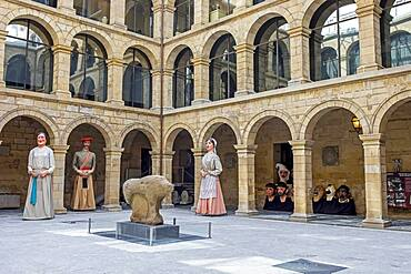 Mikeldi' and giants  in courtyard of Euskal Museoa-Basque museum. Archaeological museum of Bizkaia and Ethnographic basque. Bilbao. Spain.