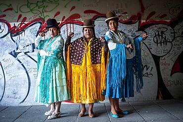 At left Benita la Intocable , in the middle Angela la Folclorista, and at right Dina, cholitas females wrestlers, El Alto, La Paz, Bolivia