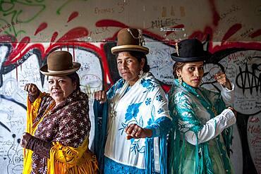 At left Angela la Folclorista , in the middle Dina, and at right Benita la Intocable, cholitas females wrestlers, El Alto, La Paz, Bolivia