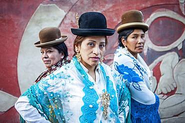 At left Angela la Folclorista , in the middle Benita la Intocable, and at right Dina, cholitas females wrestlers, El Alto, La Paz, Bolivia