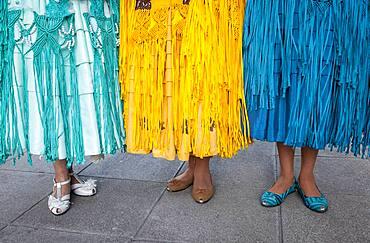 Detail of dresses and feet. At left Benita la Intocable , in the middle Angela la Folclorista, and at right Dina, cholitas females wrestlers, El Alto, La Paz, Bolivia
