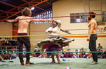 Lucha Libre. Two spontaneous up to the ring to dace with the cholita Angela la Folclorista to celebrate the victory, Sports center La Ceja, El Alto, La Paz, Bolivia