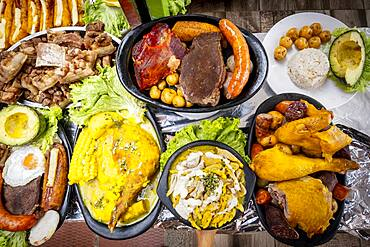 Ajiaco,chicken, sausage, black pudding, pork rinds, avocado, pollo, chorizo, morcilla, chicharron, aguacate, sancocho, soup, typical Colombian gastronomy