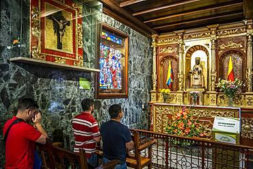 Santuario del Senor de Monserrate, people praying to Morena virgin from Montserrat or Moreneta, Church, Bogota, Colombia