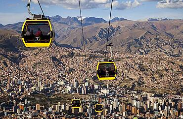 Panoramic view of the city, in background Los Andes mountains, cable car to El Alto, La Paz, Bolivia