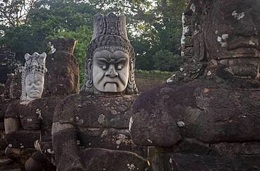 Detail, statues of Asuras on bridge of South Gate, in Angkor Thom, Siem Reap, Cambodia