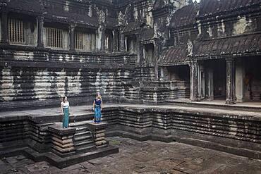 Tourists, inside Angkor Wat, Siem Reap, Cambodia