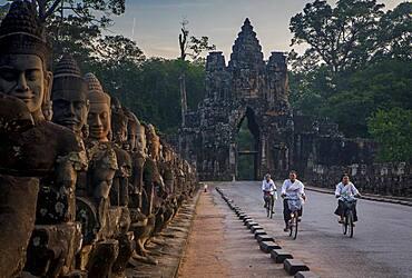 Woman, women, biking, Bridge and South Gate of Angkor Thom, Angkor, Siem Reap, Cambodia
