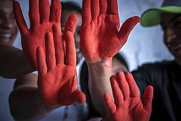 Teenagers who were child soldier during their childhood that belonged to armed groups of the Colombian conflict. The international day against the child soldier is known worldwide also as the day of the red hand, colombia
