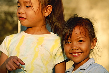 Portrait of two girls at play time in Luang Prabang City, Laos, Indochina, Southeast Asia, Asia