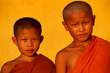 Portrait of two young monks during Buddhist Lent in Vientiane, Laos, Indochina, Southeast Asia, Asia