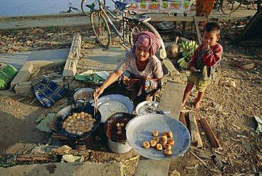 Woman selling bananas and rice balls, Cambodia, Indochina, Asia