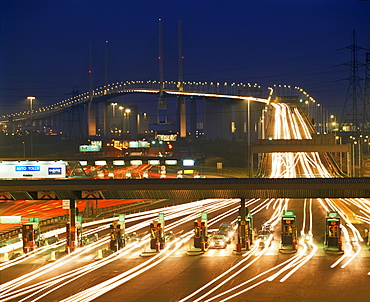 Toll booths on the south side of the Queen Elizabeth II Bridge, crossing the River Thames at Dartford at dusk, border of Kent and Essex, England, United Kingdom, Europe