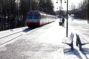 Suburban commuter train arriving at Vakas station near Oslo, Norway, Scandinavia, Europe