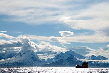 Coastal freighter and the Lyngen Alps, Troms, arctic Norway, Scandinavia, Europe