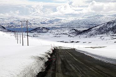 Mountain road in spring, Kvaloya (Whale Island), Troms, arctic Norway, Scandinavia, Europe
