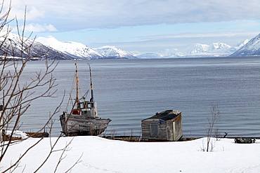 Old fishing boat laid up on Kvaloya (Whale Island), Troms, arctic Norway, Scandinavia, Europe
