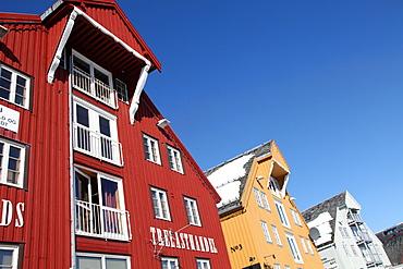 Converted warehouses along harbour front, Tromso, Troms, Norway, Scandinavia, Europe
