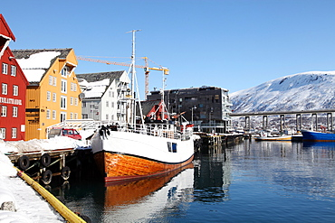 The whaler that used to go to Svalbard, with warehouses behind that have been converted into offices, Tromso, Troms, Norway, Scandinavia, Europe