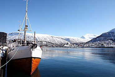 Whaler in Tromso harbour with the Bridge and Cathedral in background, Tromso, Troms, Norway, Scandinavia, Europe