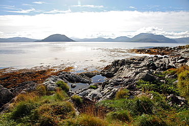 Sunlit rocks and foreshore, Helgoy, Kvalsund, Troms, North Norway, Norway, Scandinavia, Europe