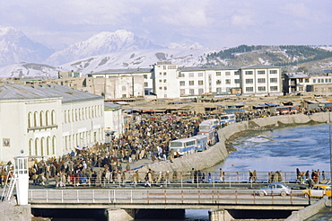 Crowds of people and buses in the city, Kabul, Afghanistan