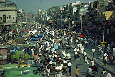 Busy street in Old Delhi, looking towards Red Fort in distance, Delhi, India, Asia
