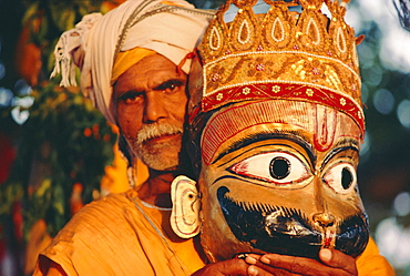 Actor and mask from the Ramlilla, the stage play of the Hindu Epic the Ramayana, Varanasi (Benares), Uttar Pradesh State, India
