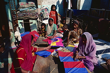 Muslim women making vast quantities of tissue paper kites for January kite festival, Ahmedabad, Gujarat, India, Asia