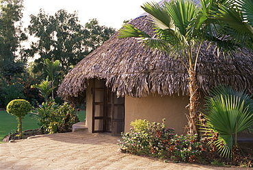 Modern residential home in traditional tribal Rabari round mud hut, Bunga style. near Ahmedabad, Gujarat state, India, Asia