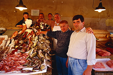 Fishermen in the Marsala fish market in Marsala on the island of Sicily, Italy, Europe